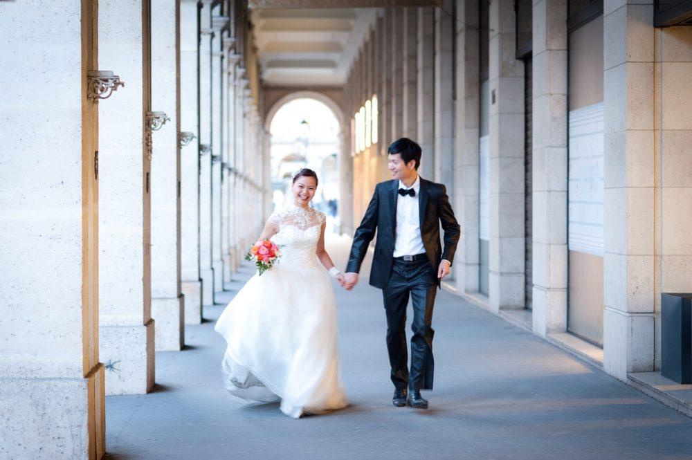 Paris Photographer bride and groom running in Paris