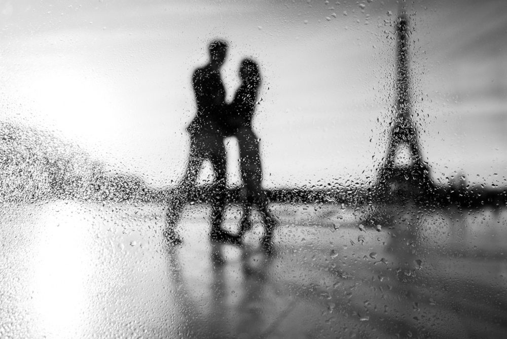 Paris Photographer rain drops Eiffel Tower engagement