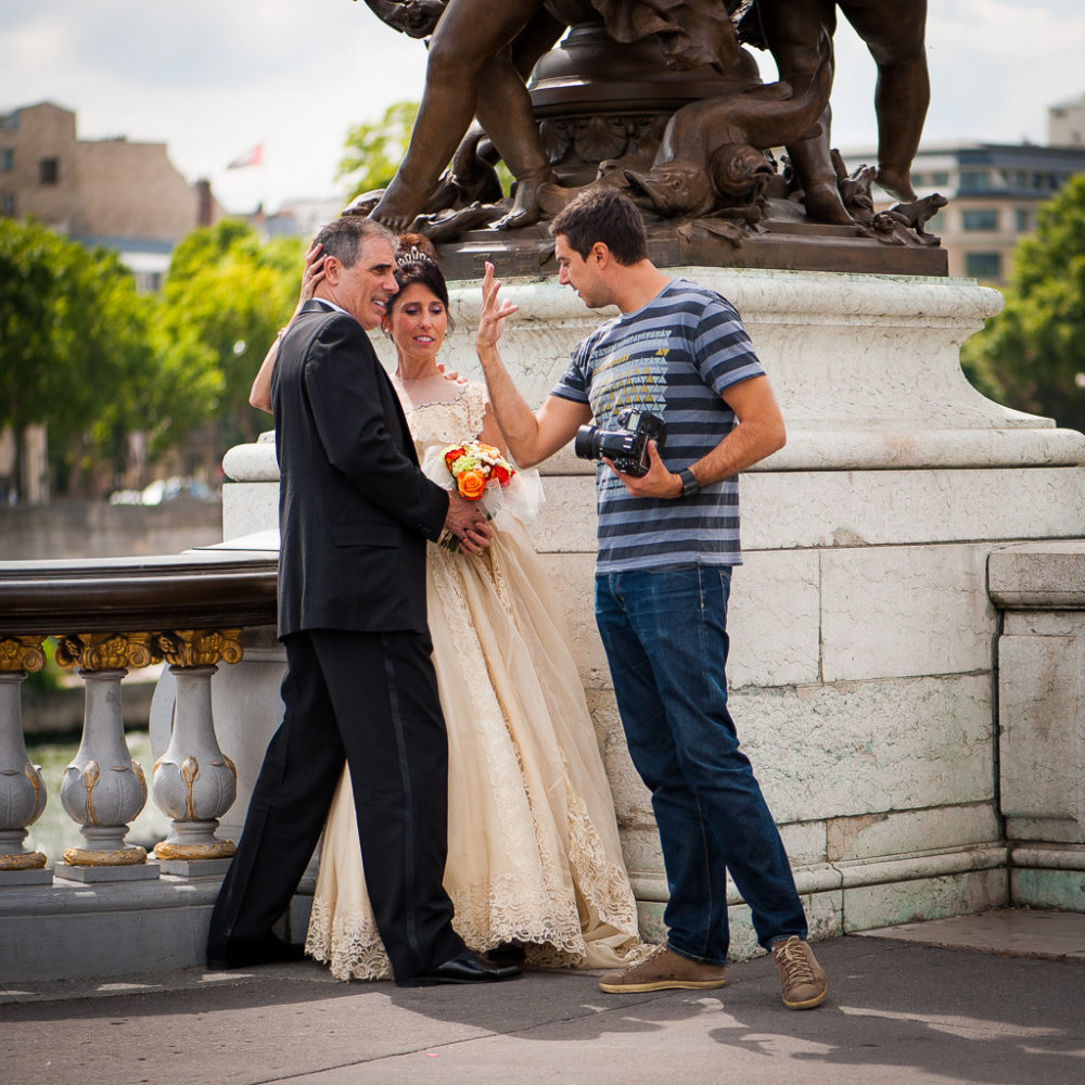 Paris Photographer talking to bride and groom