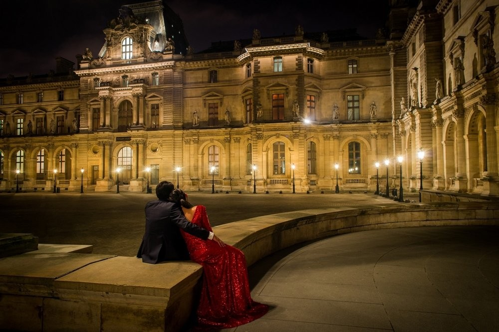 Paris engagement photographer couple at Louvre Museum