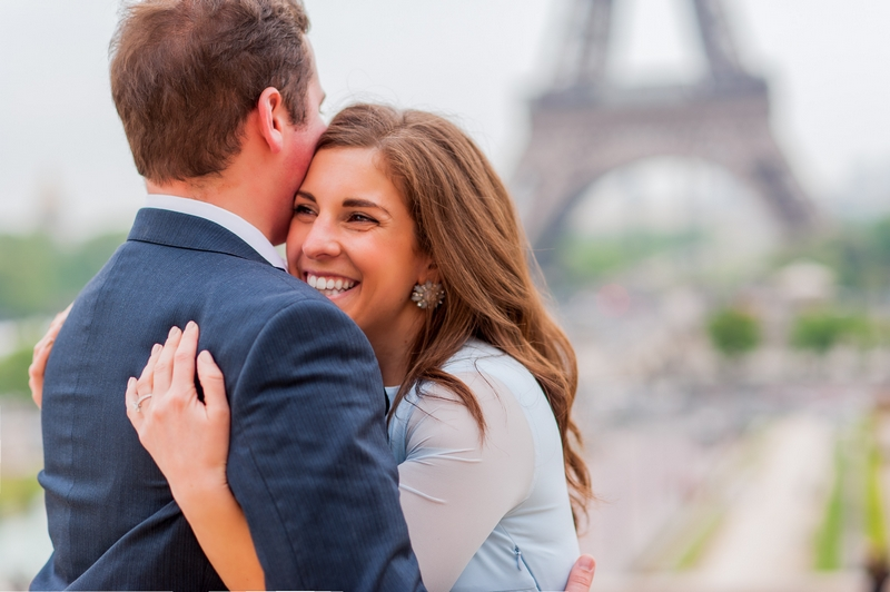 Engagement pictures in Paris couple hugging at Eiffel Tower