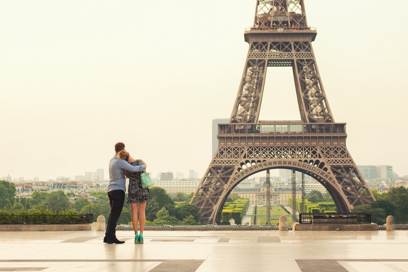 Couple looking at the Eiffel Tower before proposing in Paris