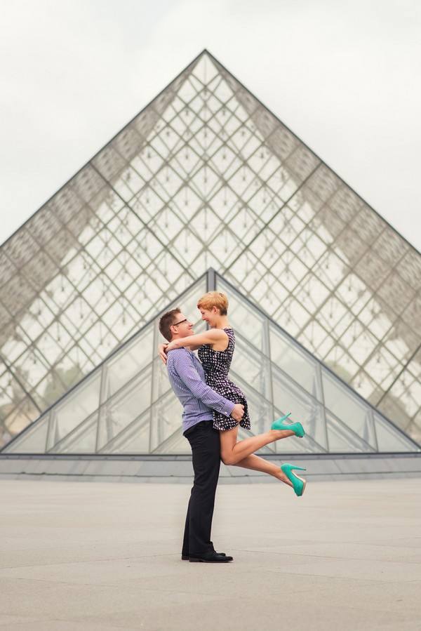 Newly engaged couple celebrating in Paris