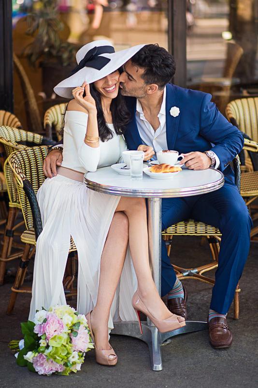 Kiss under the hat in a Parisian café