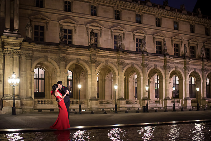 Engagement photos at night at Louvre Museum