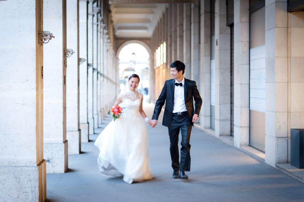 Paris Photographer bride and groom running in Paris
