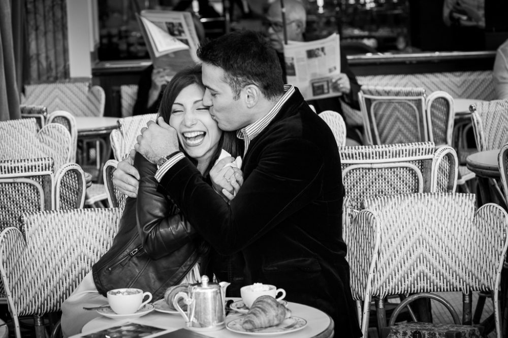 Paris engagement photographer couple in cafe trocadero paris