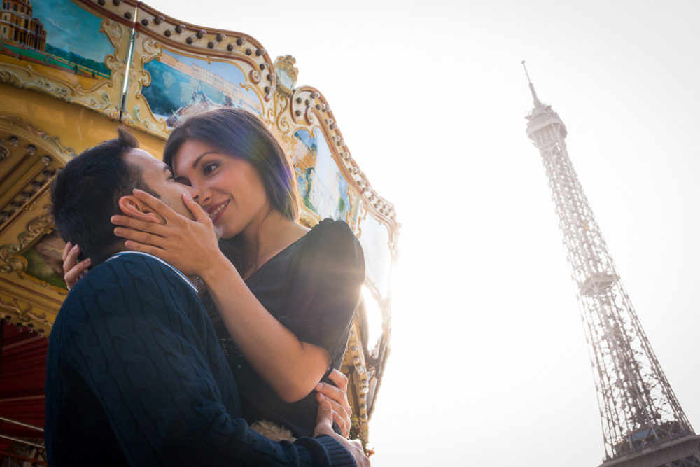 engagement photos in Paris carrousel eiffel tower
