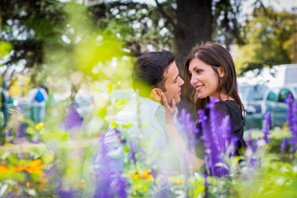 paris engagement photos couple between flowers le petit palais