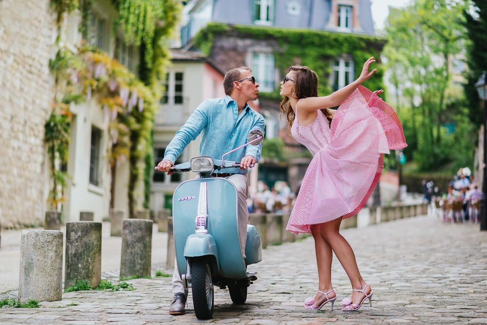 Paris photographer iconic couples photo with vintage Vespa