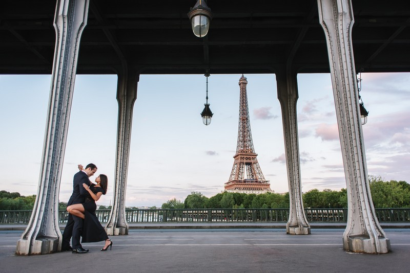 Paris postcard view from Bir Hakeim bridge during couples photo session in Paris
