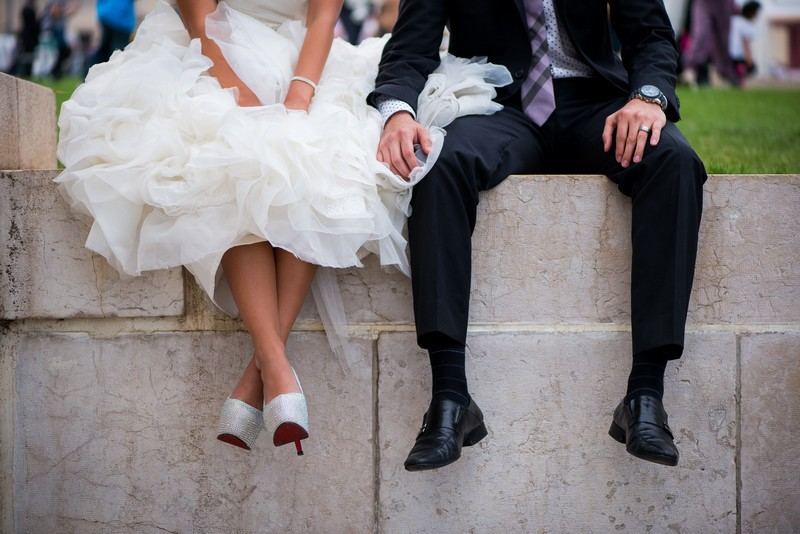 Couple on honeymoon and bride with Louboutin shoes