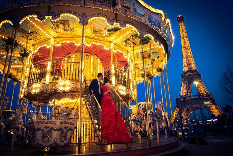 Pre wedding photo shoot Paris carousel Eiffel Tower
