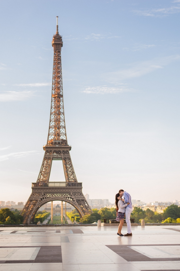 Couple kiss after proposing at the Eiffel Tower