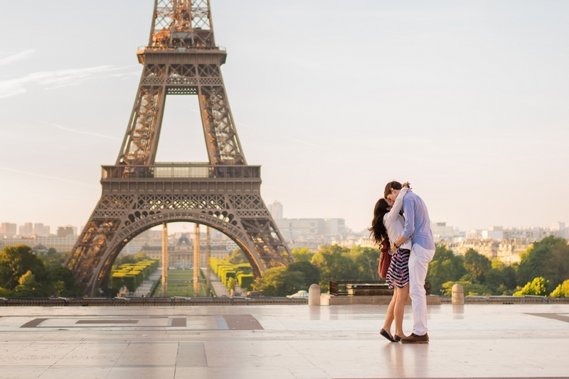 Couple passionate kissing after proposal in Paris