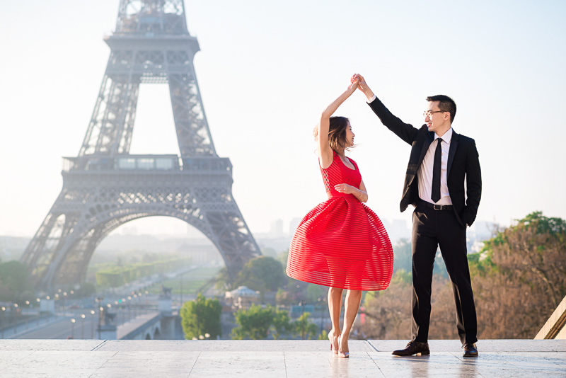 Dancing twirling in front of the Eiffel Tower