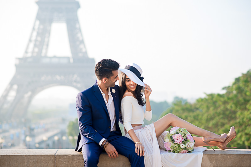 Couple from California taking engagement photos in Paris