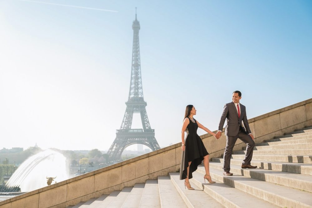 Paris photographer Ioana – couple in love walking up the stairs of Trocadero