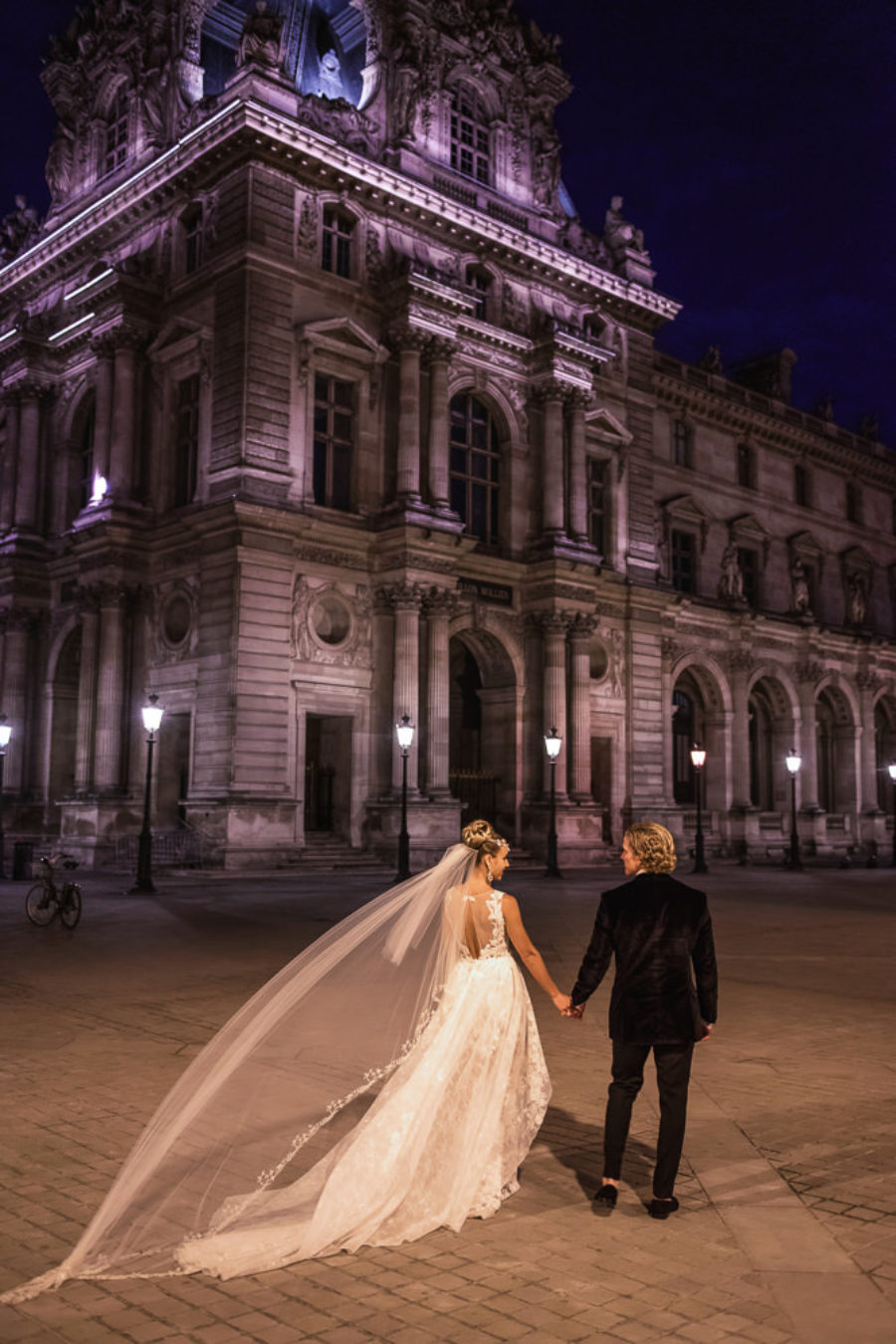 Bride and groom eloping to Paris at night at Louvre Museum
