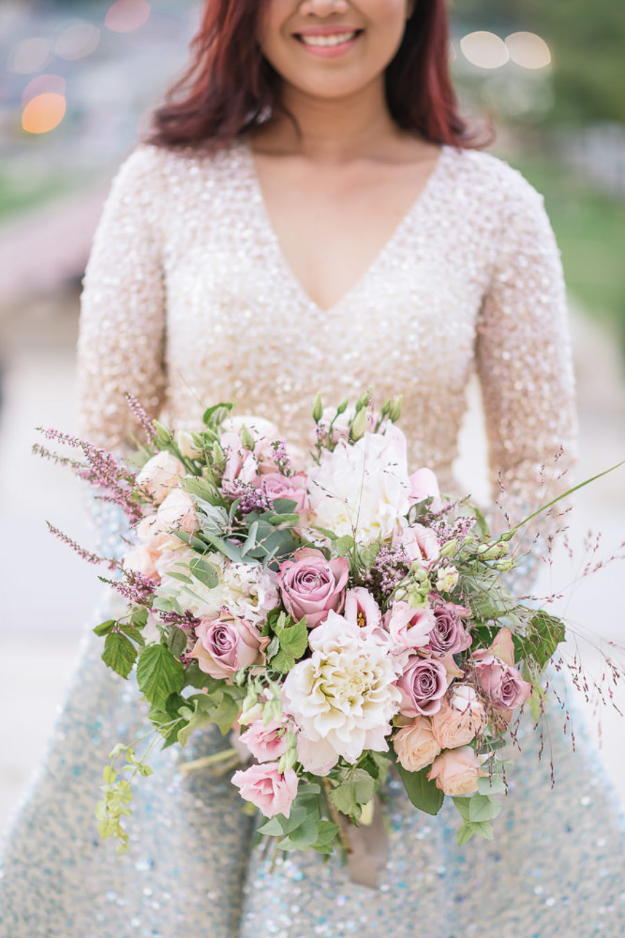 sophisticated wedding bouquet and designer wedding dress
