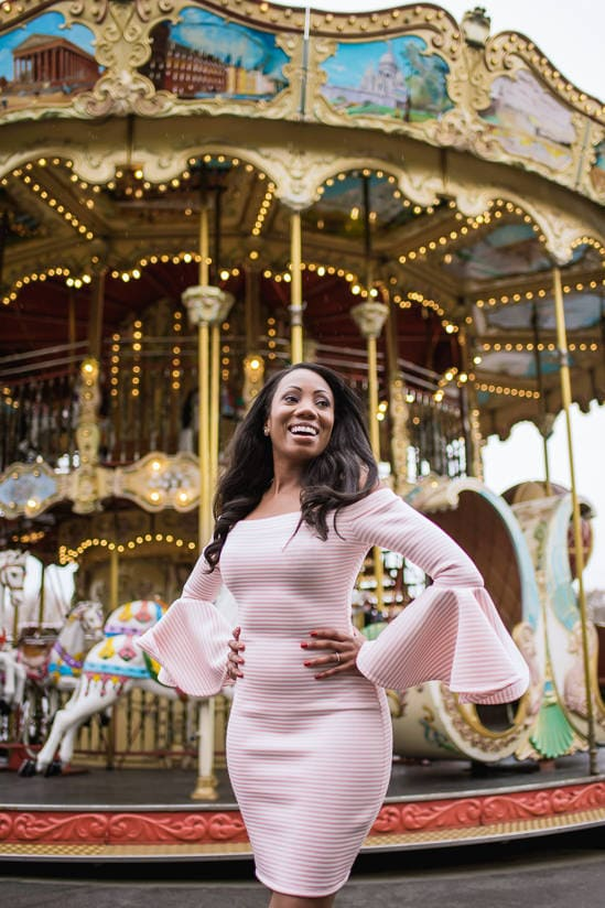 Beautiful black girl dressed in pink smiling in Paris