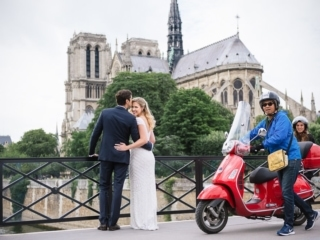 Couples portraits ideas – Bride and groom behind Notre Dame posing on their wedding day