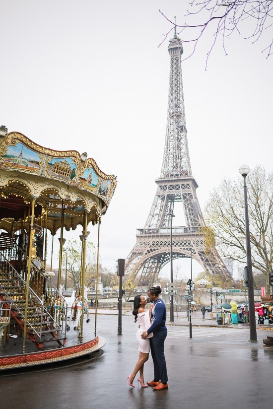 Kissin in the street near the Carousel of the Eiffel Tower