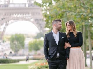Fine art portrait of an elegant couple in Paris France at the Eiffel Tower