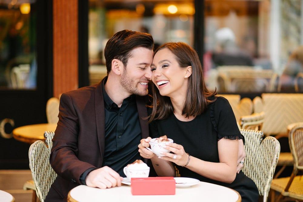 Fun couple photoshoot ideas - spending time in a cute Parisian café over a cappuccino and macarons