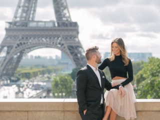 Paris photography - romantic picture of a couple in love at the Eiffel Tower in Paris, France