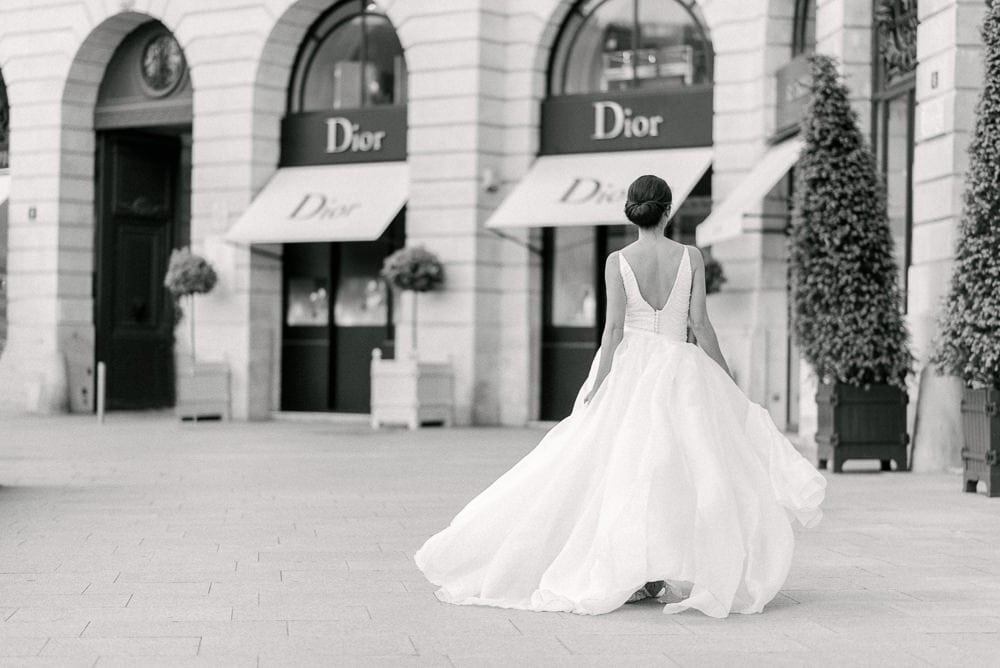 best places to take pictures in paris with bride running towards dior shops