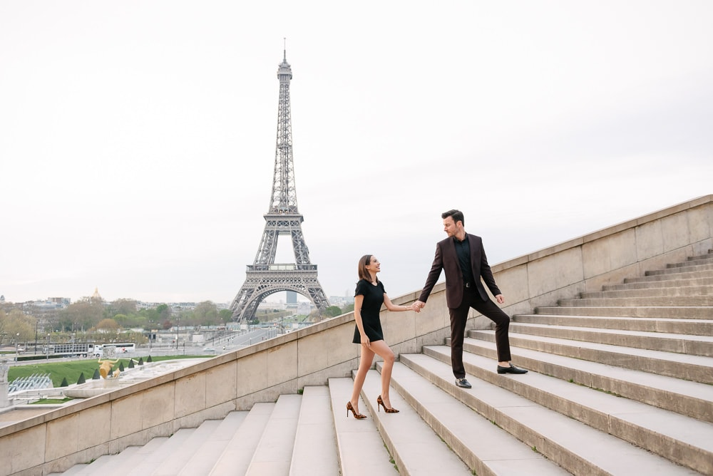 couples photo poses ideas - walking up on stairs