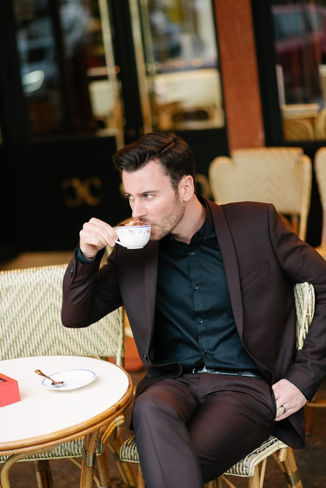 couples portrait ideas - young man drinking coffee in a parisian café