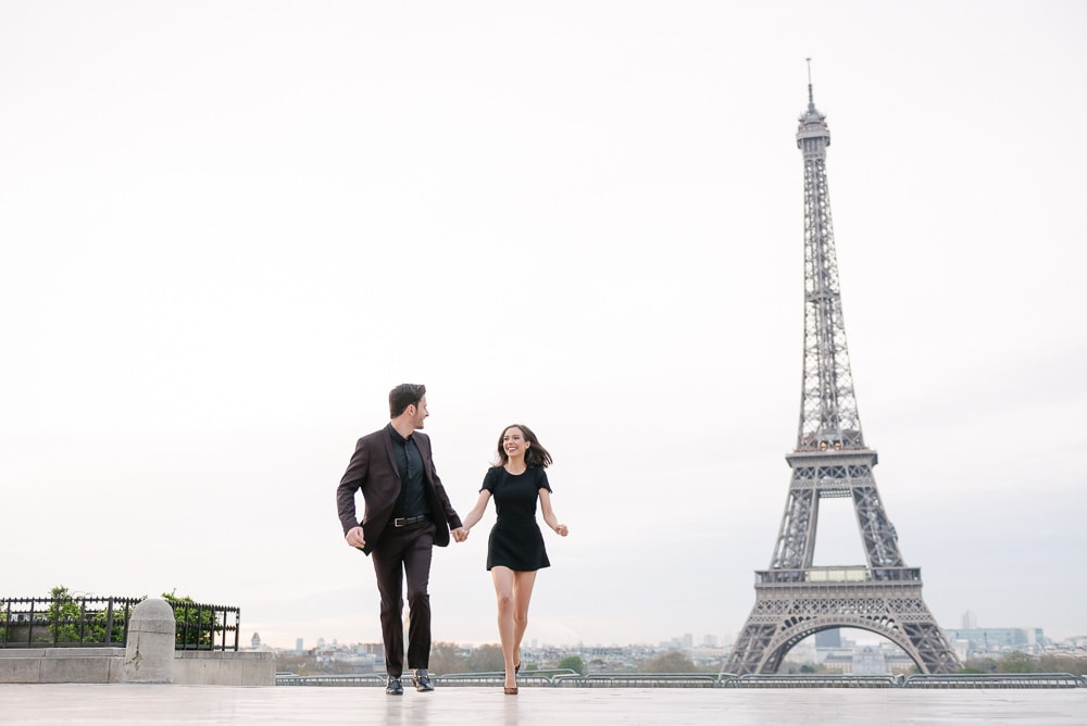 picture ideas for couples - young couple running towards the camera in Paris, France