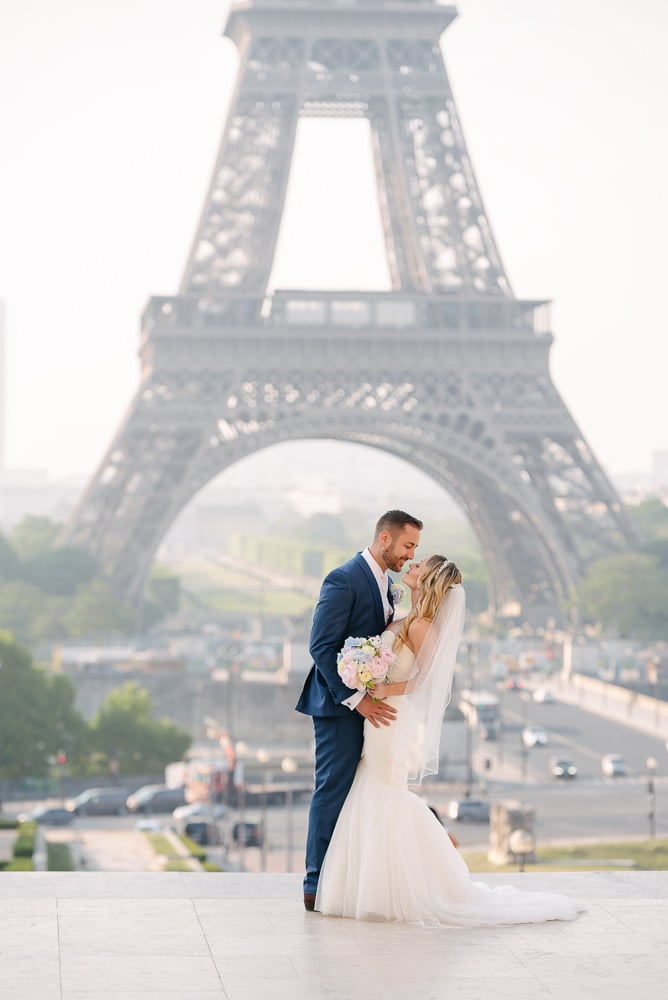 Bride and groom beautiful portrait at the Eiffel Tower in Paris 2