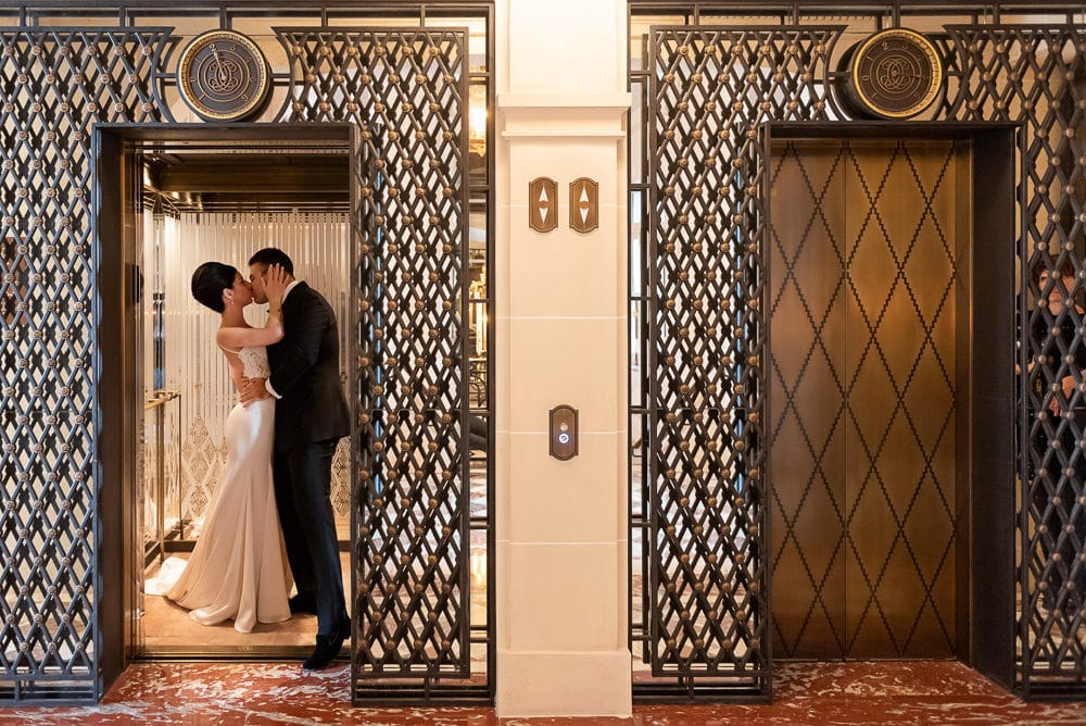 Hotel Crillon Paris wedding -Bride and groom passionately kissing in the hotel elevator